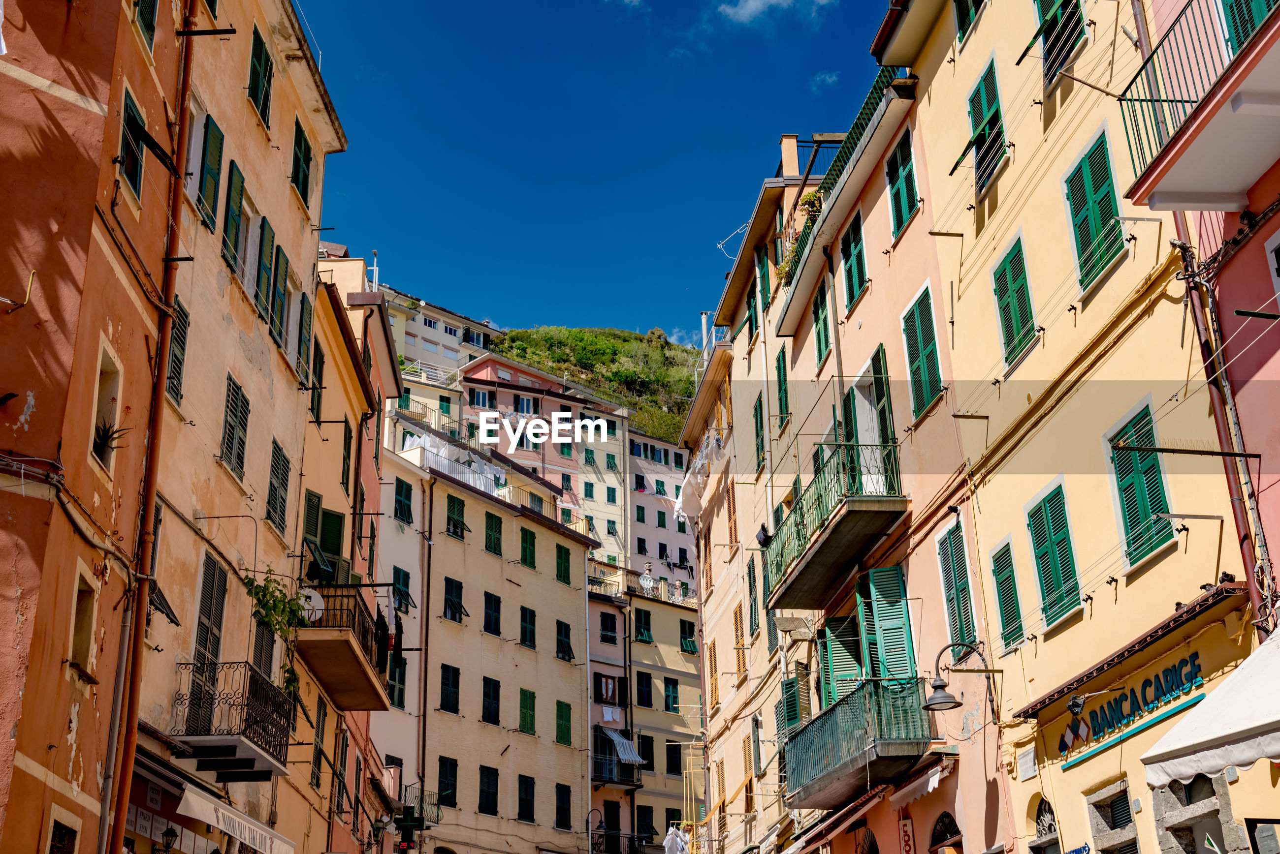 Low angle view of buildings against sky at riomaggiore