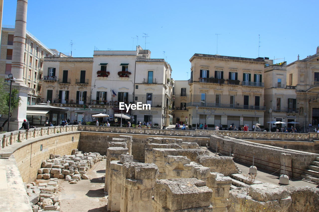 Roman forum in city on sunny day