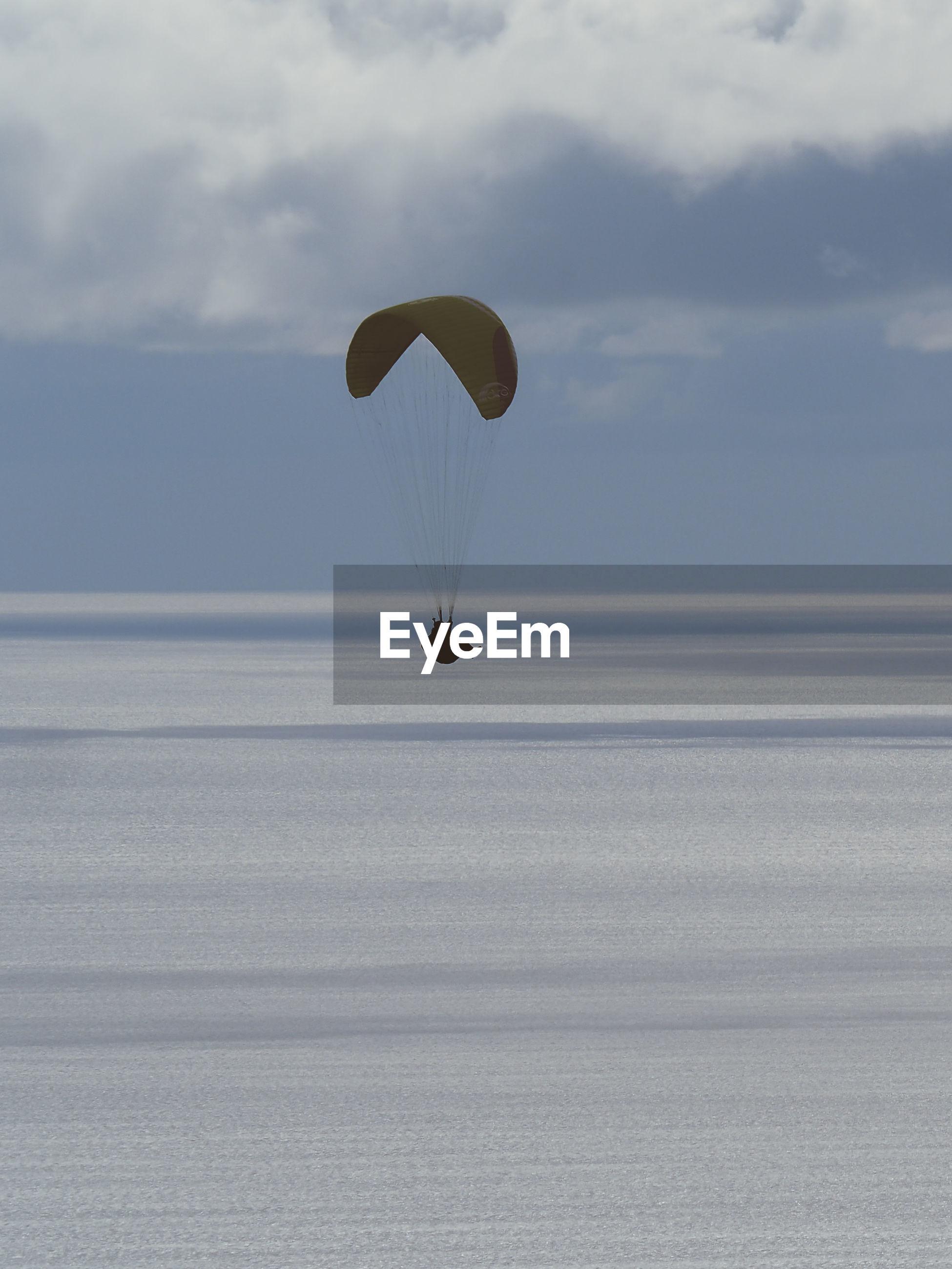 PEOPLE IN SEA AGAINST SKY