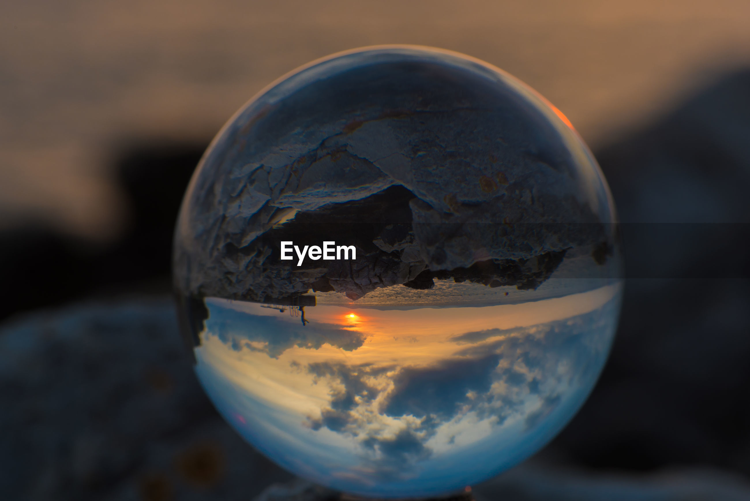 CLOSE-UP OF CRYSTAL BALL IN GLASS