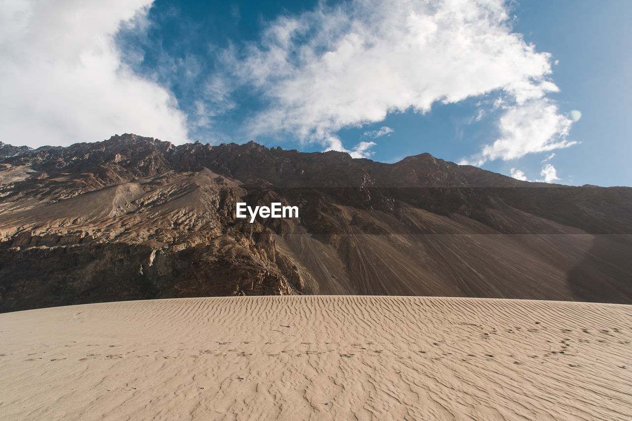 Desert and mountain against sky
