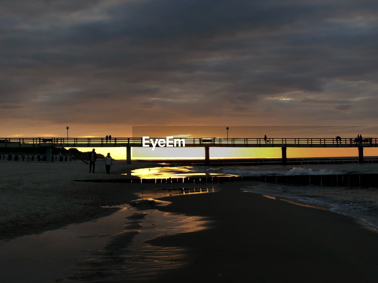 sky, cloud - sky, sunset, water, sea, built structure, nature, architecture, connection, scenics - nature, bridge, beauty in nature, land, bridge - man made structure, no people, beach, tranquility, transportation, tranquil scene, outdoors