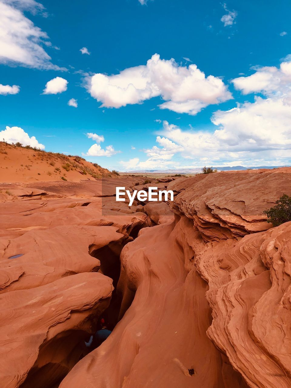 cloud - sky, sky, scenics - nature, tranquil scene, non-urban scene, tranquility, beauty in nature, landscape, environment, land, climate, arid climate, desert, physical geography, nature, rock formation, remote, day, sand, rock, no people, eroded