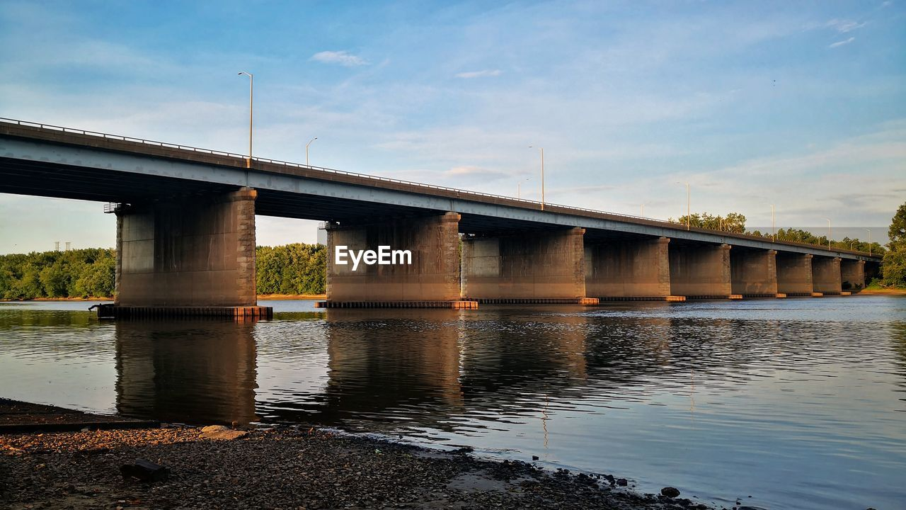 bridge, bridge - man made structure, water, built structure, architecture, connection, sky, transportation, river, reflection, nature, engineering, architectural column, cloud - sky, waterfront, outdoors, day, low angle view