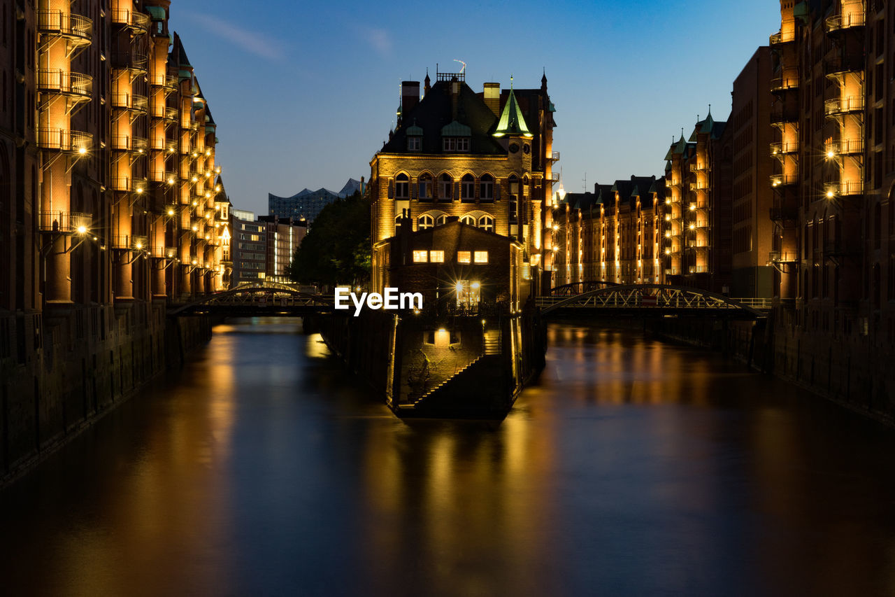architecture, built structure, building exterior, water, illuminated, reflection, waterfront, bridge, city, sky, building, connection, bridge - man made structure, night, nature, no people, canal, transportation, outdoors