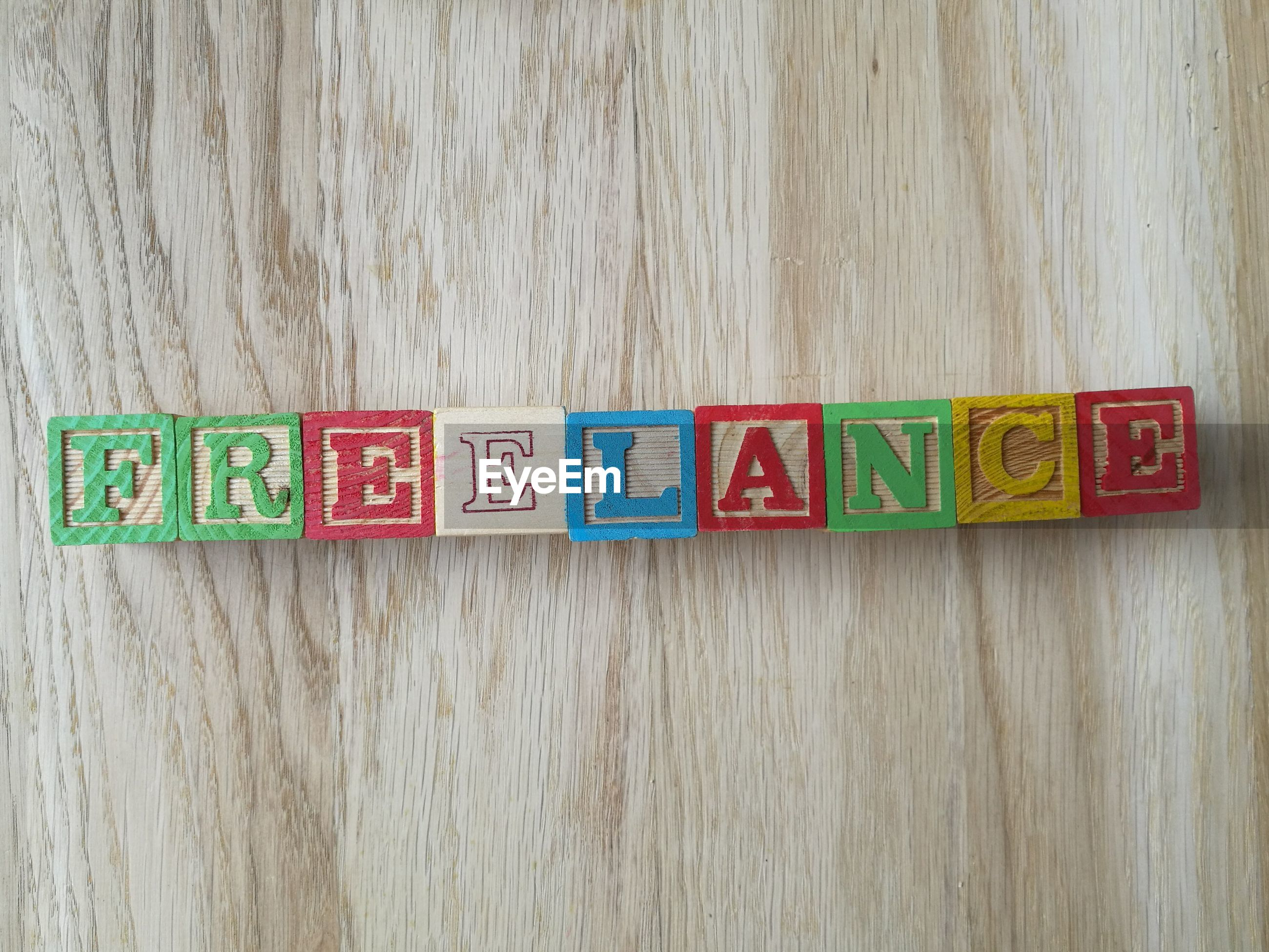 Directly above shot of freelance text made from toy blocks