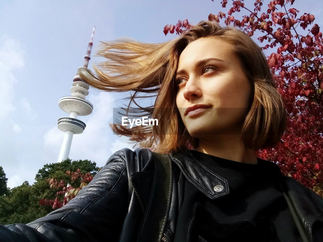 Beautiful Woman In City Against Sky