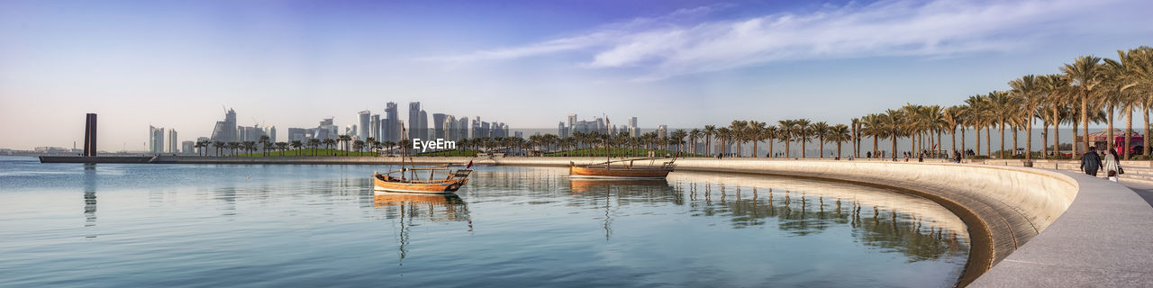 water, architecture, built structure, sky, building exterior, city, building, office building exterior, nature, skyscraper, waterfront, nautical vessel, transportation, urban skyline, travel destinations, incidental people, tall - high, day, panoramic, outdoors, cityscape, financial district