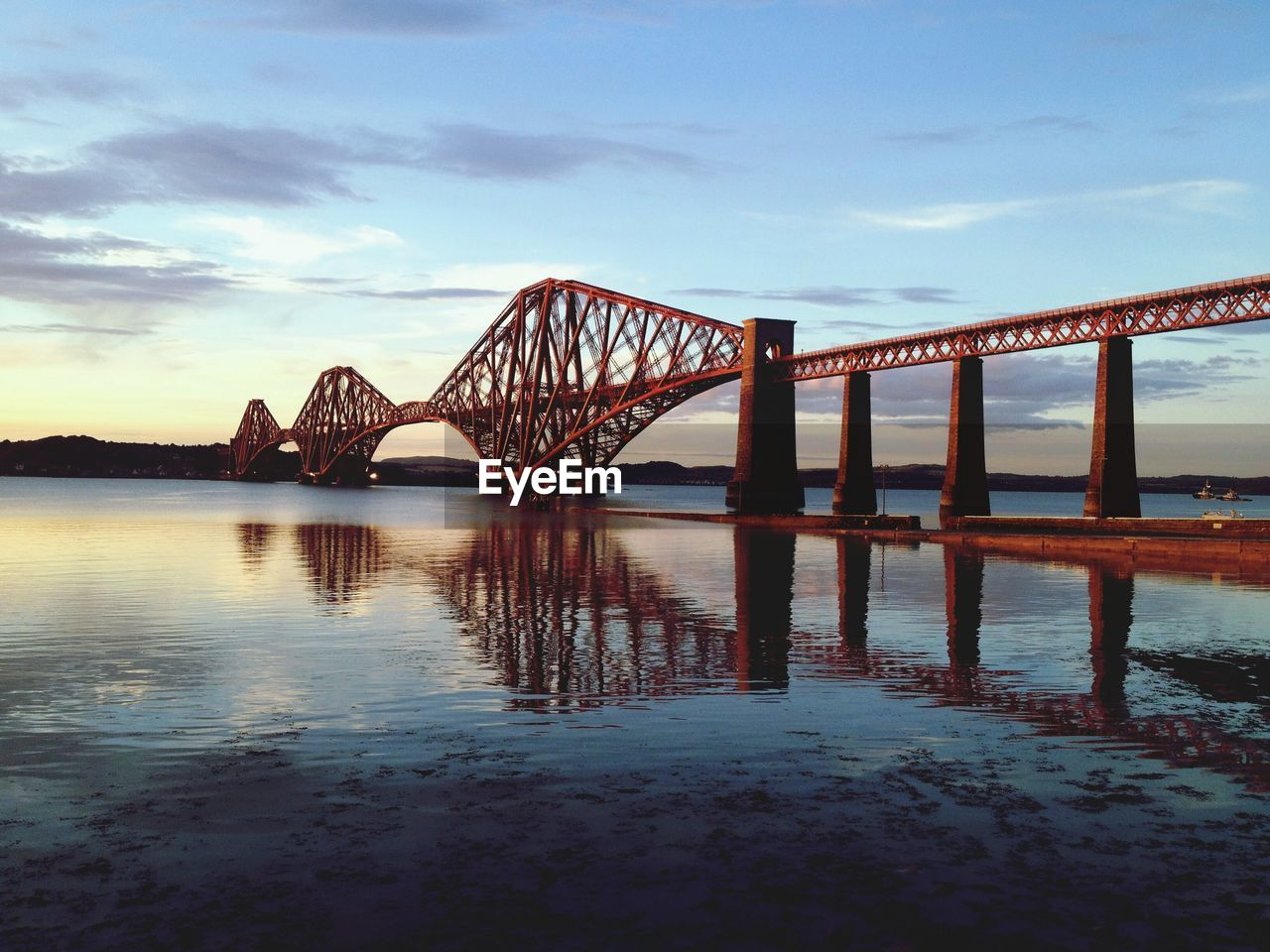 Firth Of Forth Rail Bridge Over River Against Sky At Dusk