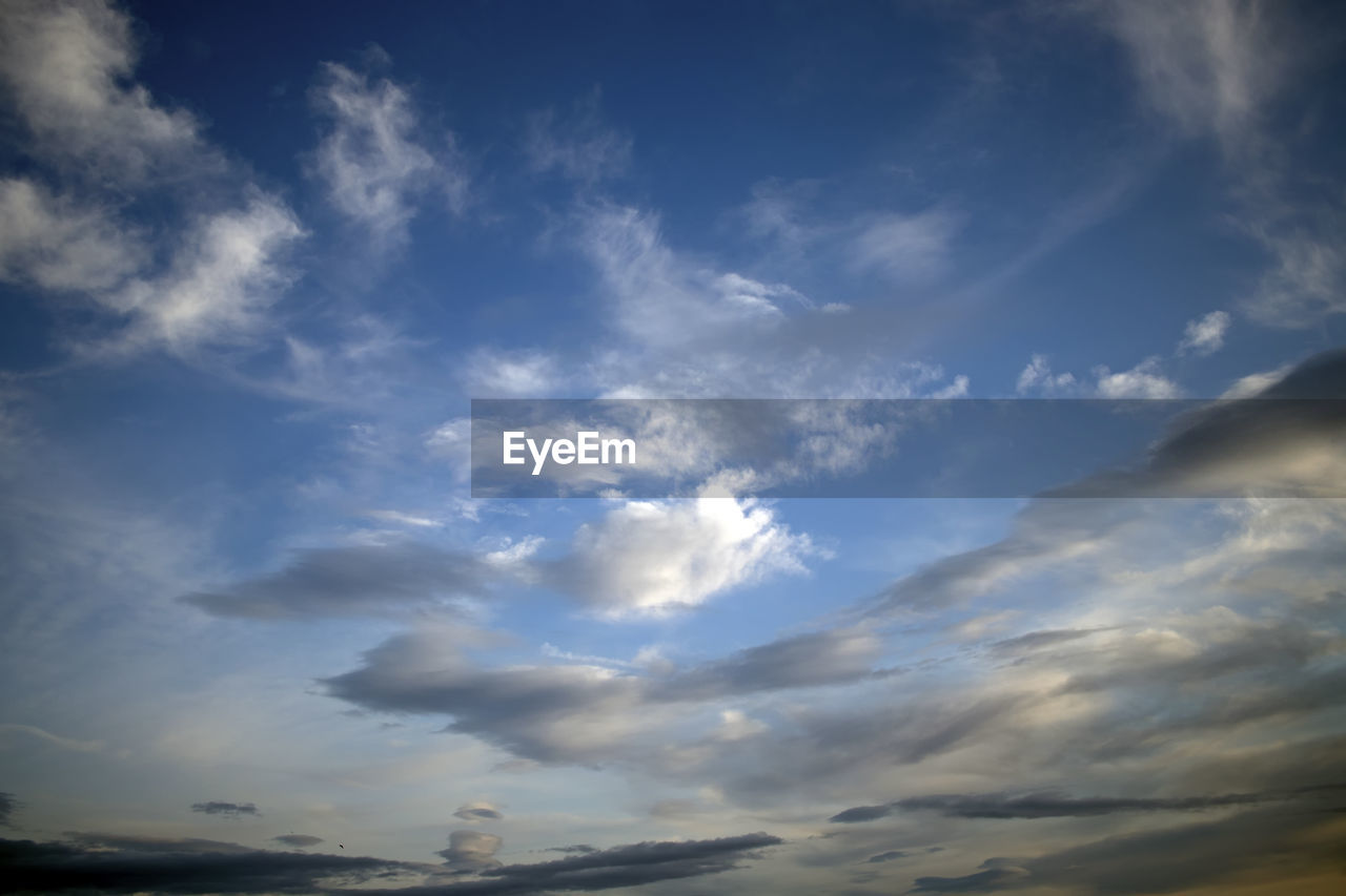 cloud - sky, sky, beauty in nature, scenics - nature, low angle view, no people, tranquility, nature, tranquil scene, day, outdoors, blue, idyllic, backgrounds, non-urban scene, white color, cloudscape, sunset, dramatic sky, meteorology