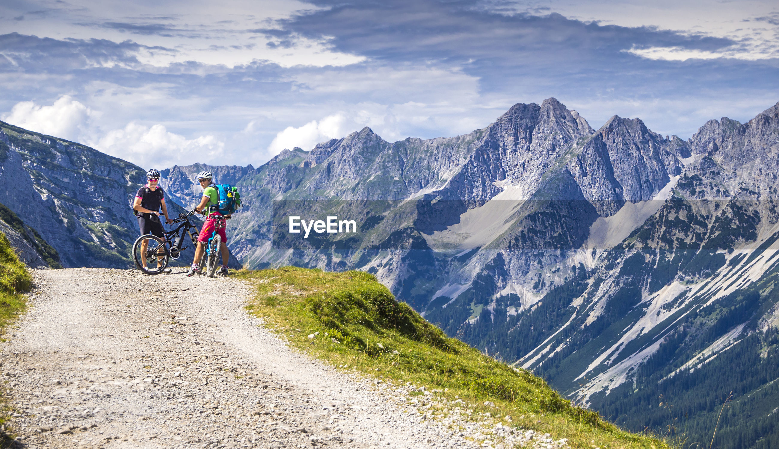 People riding bicycle on mountain