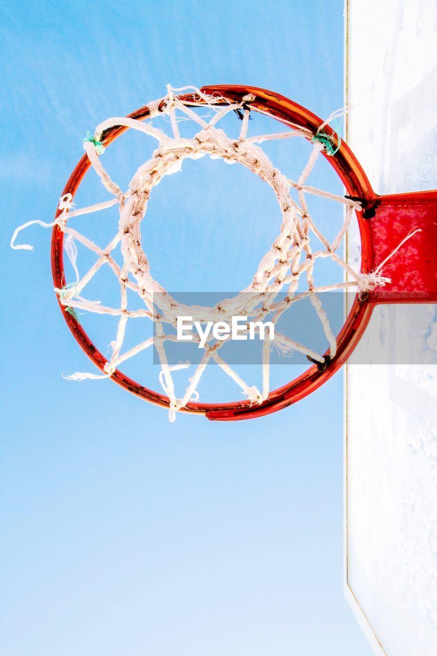 Directly below view of basketball hoop against clear sky