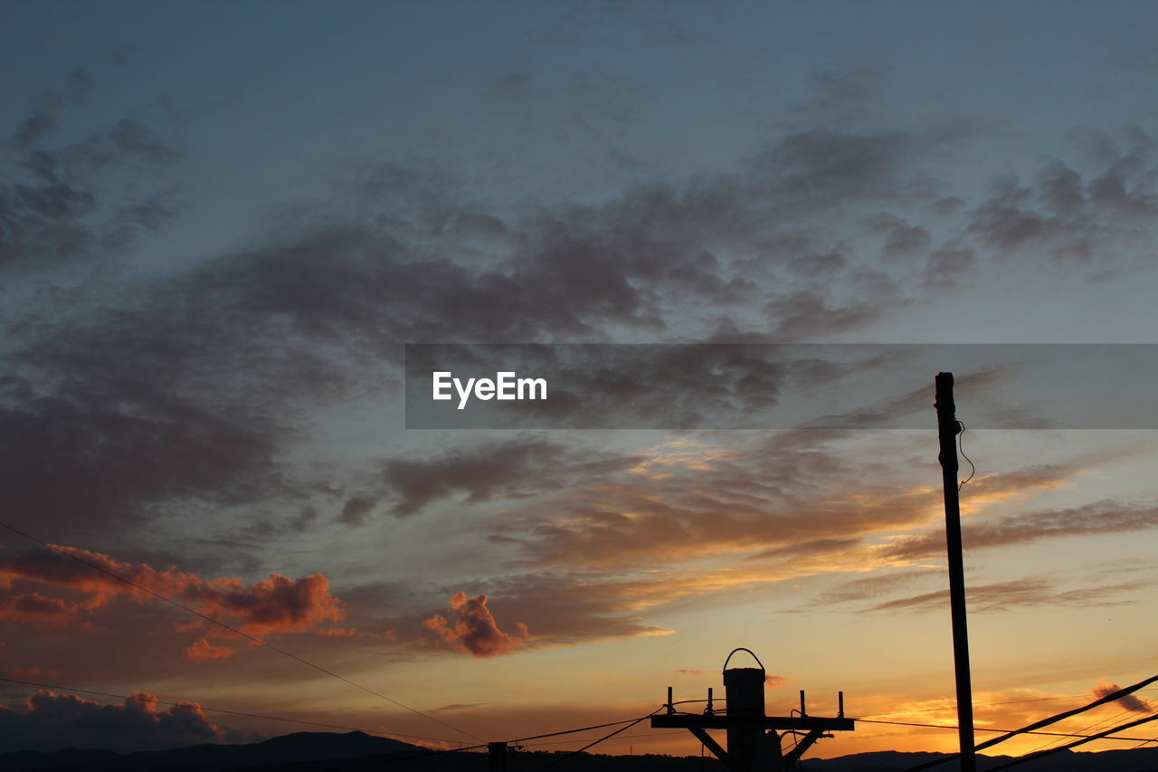 cloud - sky, sky, sunset, beauty in nature, orange color, nature, architecture, no people, silhouette, technology, built structure, scenics - nature, satellite, communication, satellite dish, building exterior, outdoors, low angle view, connection