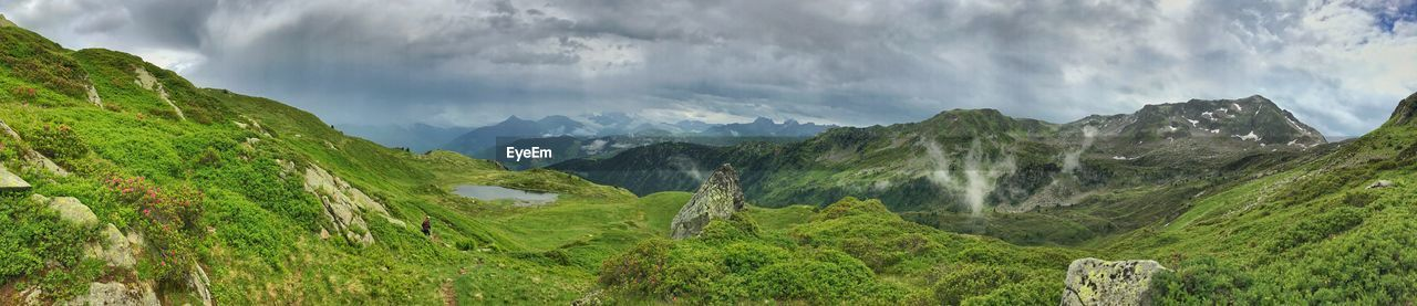 mountain, cloud - sky, beauty in nature, scenics - nature, panoramic, tranquil scene, sky, landscape, tranquility, environment, green color, nature, non-urban scene, plant, mountain range, no people, idyllic, day, land, travel, outdoors, mountain peak, range