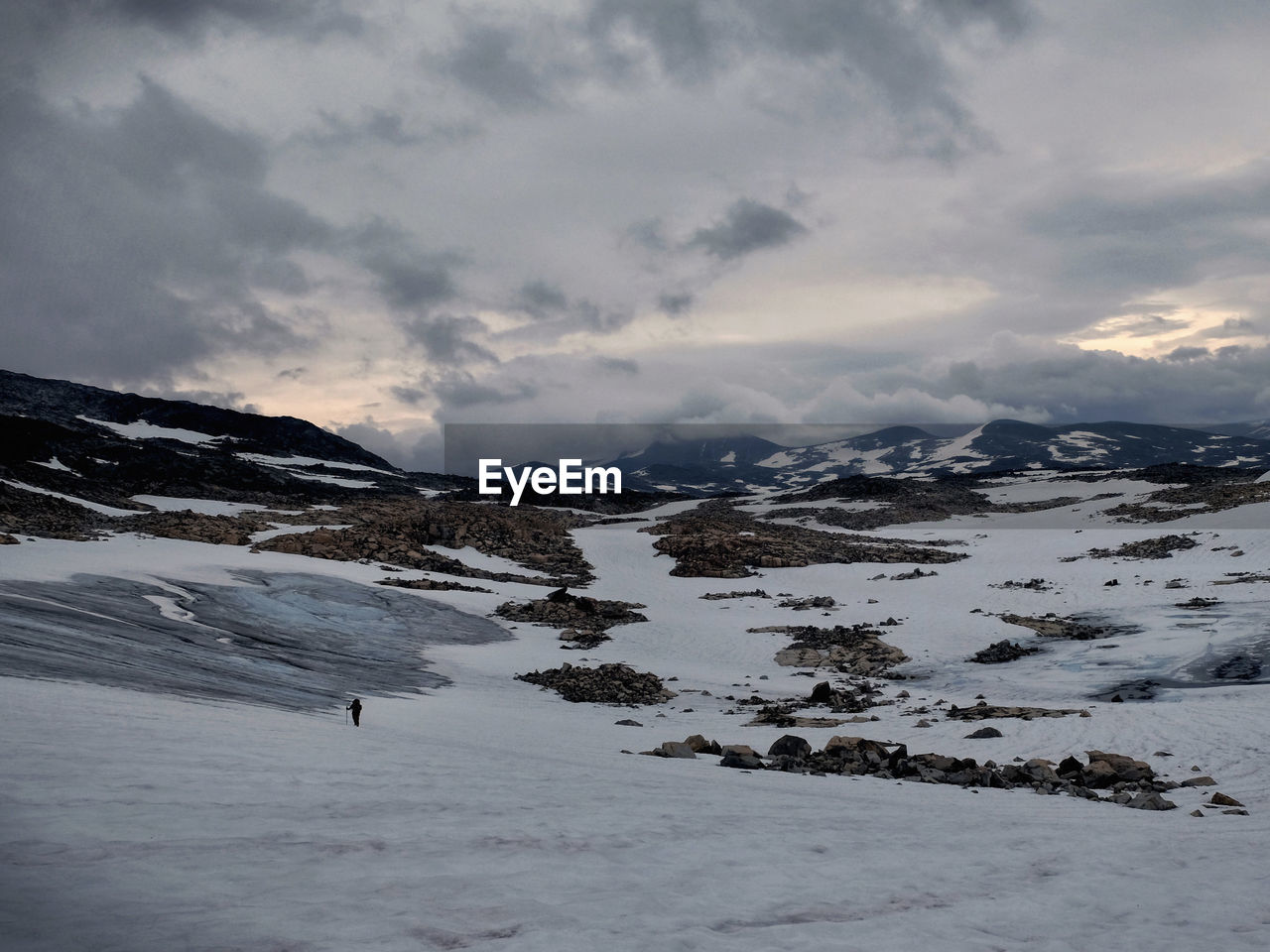 lonely hiker in Breheimen National Park in Norway where you can experience barren mountains, streaming rivers, opalescent glaciers and rough untouched nature. Breheimen Lonely National Park Norway The Great Outdoors - 2018 EyeEm Awards Adventure Beauty In Nature Cold Temperature Environment Freedom Landscape Mountain Mountain Peak Mountain Range Nature No People Non-urban Scene Norway Nature Outdoors Remote Snow Wilderness
