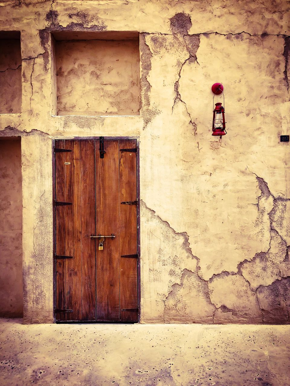 building exterior, architecture, built structure, entrance, door, safety, security, protection, wall - building feature, no people, closed, building, day, wood - material, outdoors, old, house, red, weathered, wall