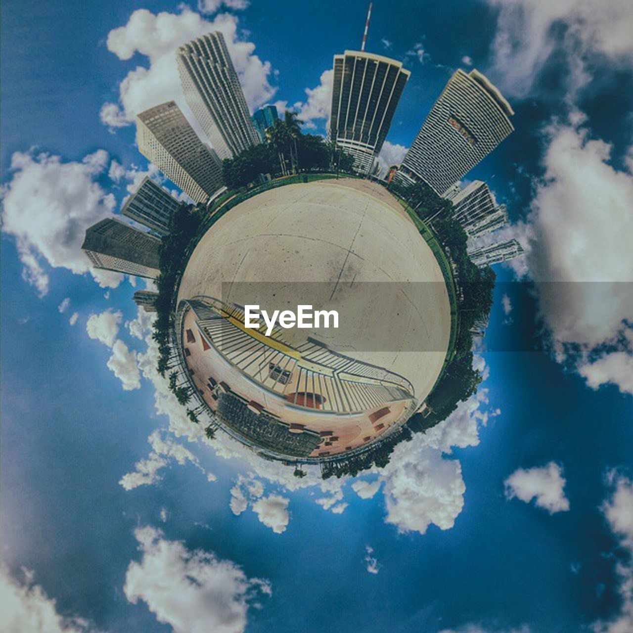 architecture, cloud - sky, sky, building exterior, built structure, low angle view, skyscraper, no people, day, city, outdoors, modern, cityscape, tree, fish-eye lens, planet earth