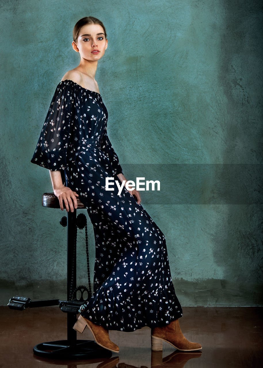 one person, dress, portrait, standing, looking at camera, beautiful woman, polka dot, casual clothing, confidence, young adult, fashion, indoors, full length, real people, one woman only, lifestyles, young women, one young woman only, day, only women, adult, people, adults only