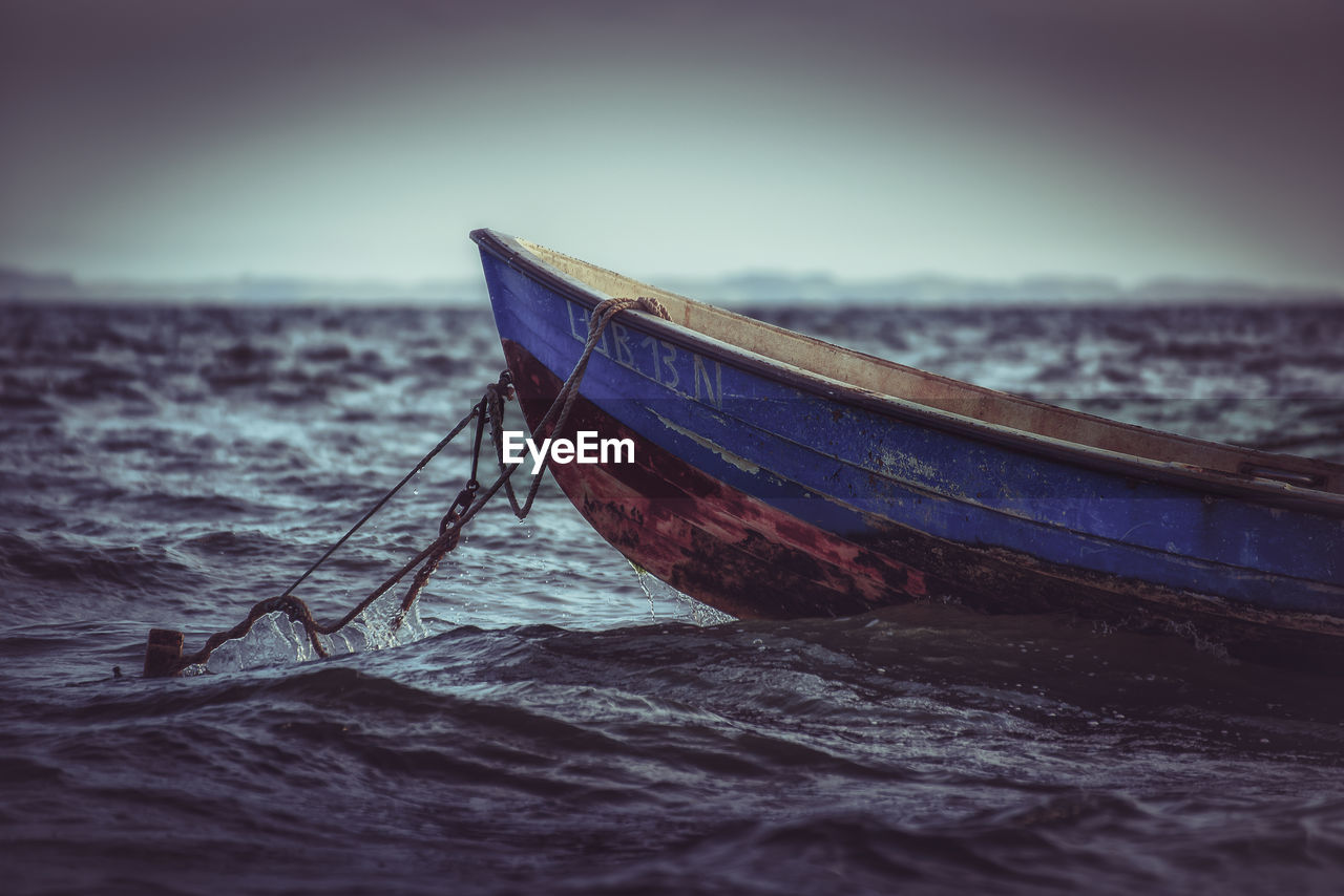 nautical vessel, water, sea, sky, transportation, mode of transportation, beach, land, nature, moored, tranquility, no people, scenics - nature, day, beauty in nature, horizon, tranquil scene, outdoors, wave, horizon over water, fishing boat