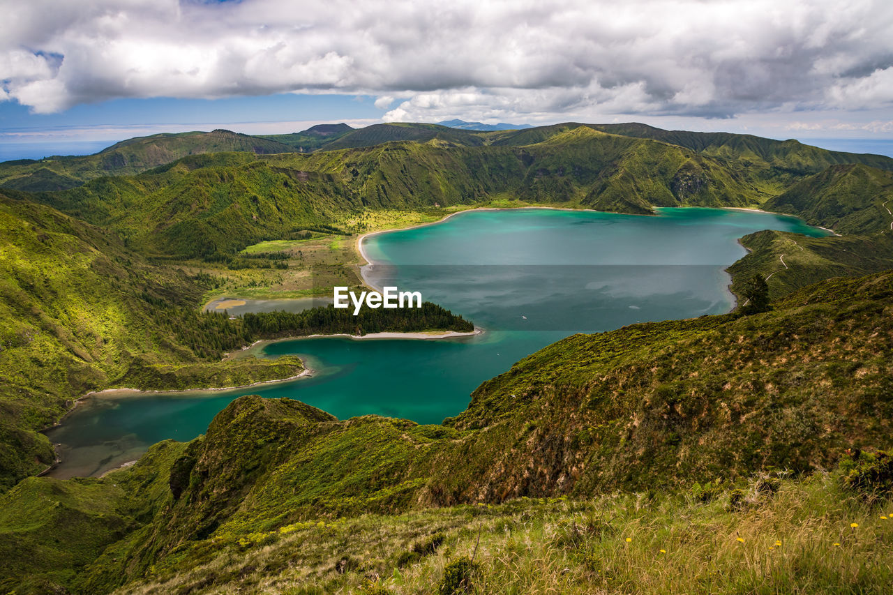 Mysticism and magic at the viewpoint on the turquoise mountain lake lagoa do fogo in the azores
