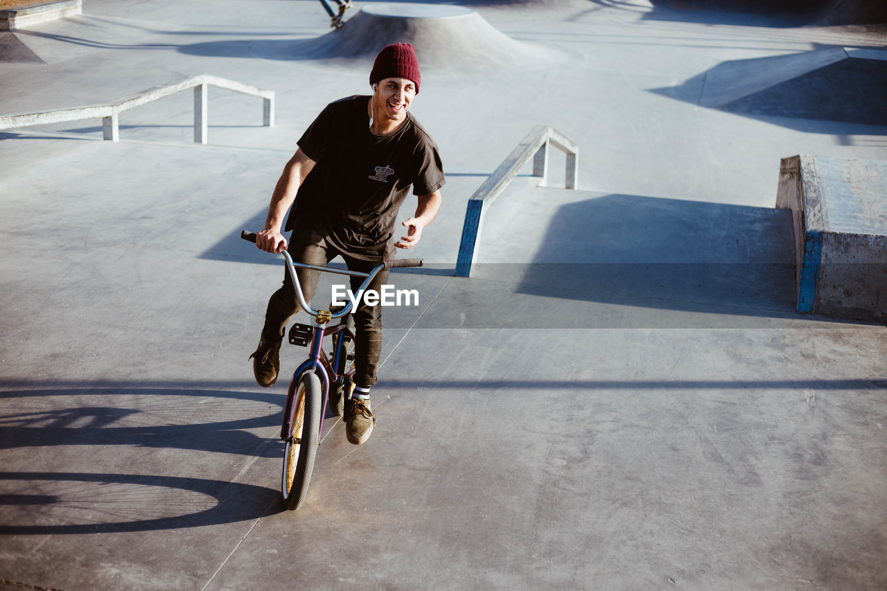 bicycle, one person, lifestyles, leisure activity, real people, full length, transportation, skateboard park, sport, casual clothing, day, men, activity, shadow, young men, sunlight, riding, young adult, ride, skill, outdoors, teenager