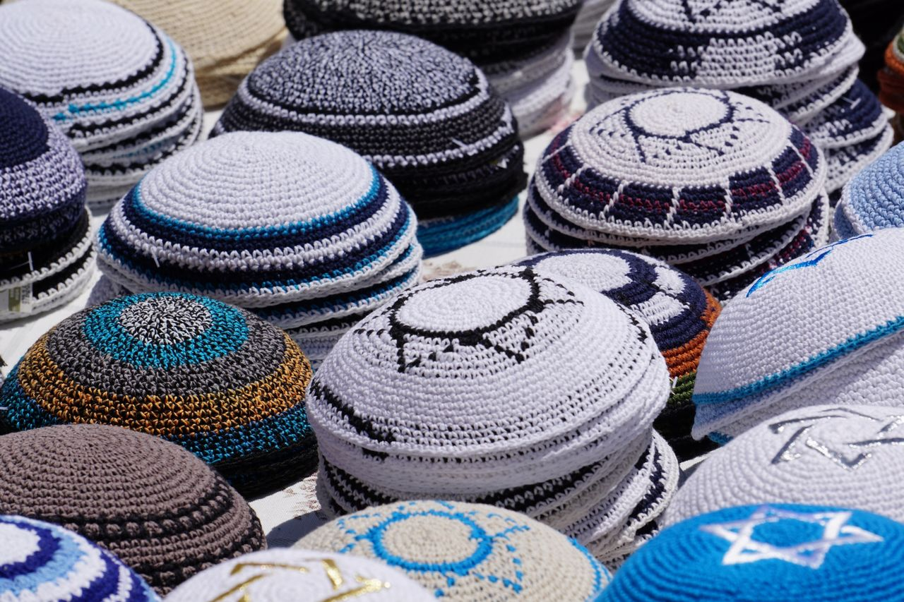 Multi colored islamic headwear for sale at market stall