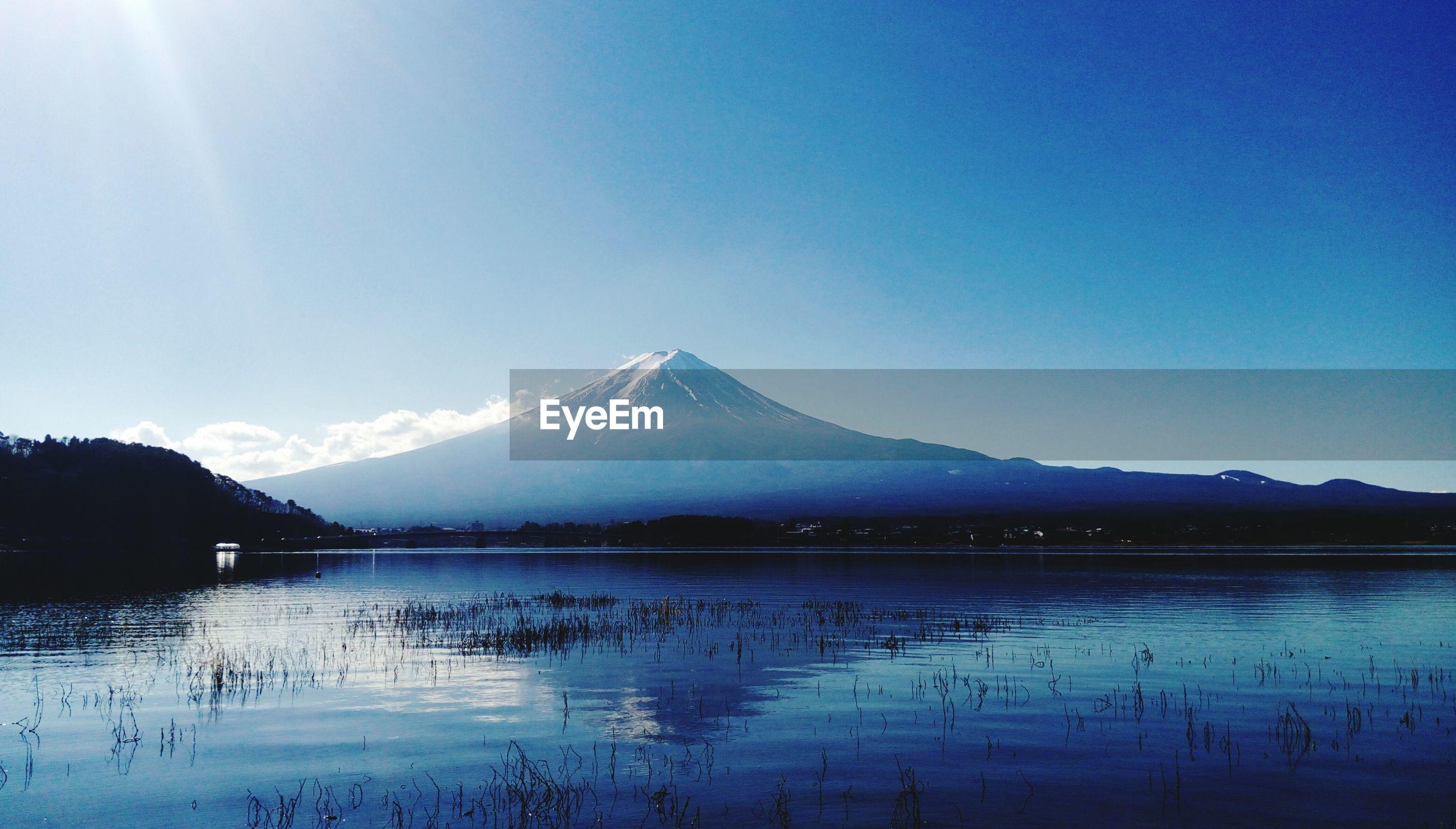 Scenic view of mt fuji reflection in lake kawaguchi against sky