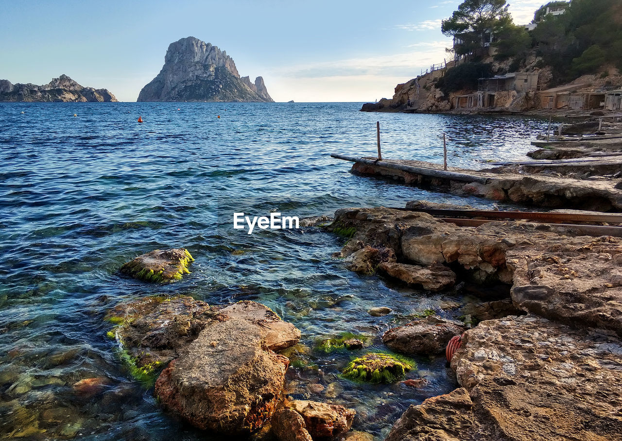 water, rock, rock - object, sea, solid, beauty in nature, scenics - nature, sky, tranquility, rock formation, tranquil scene, nature, land, beach, no people, day, outdoors, idyllic, non-urban scene, rocky coastline
