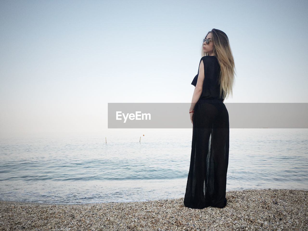 sea, sky, one person, water, horizon, land, beauty in nature, scenics - nature, beach, lifestyles, leisure activity, real people, young women, horizon over water, tranquility, young adult, long hair, beauty, standing, hair, beautiful woman, hairstyle, fashion