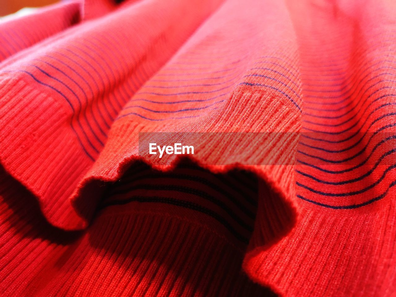 textile, indoors, red, close-up, no people, pattern, shadow, still life, backgrounds, wool, single object, full frame, sunlight, textured, selective focus, material, furniture, man made object, man made, paper