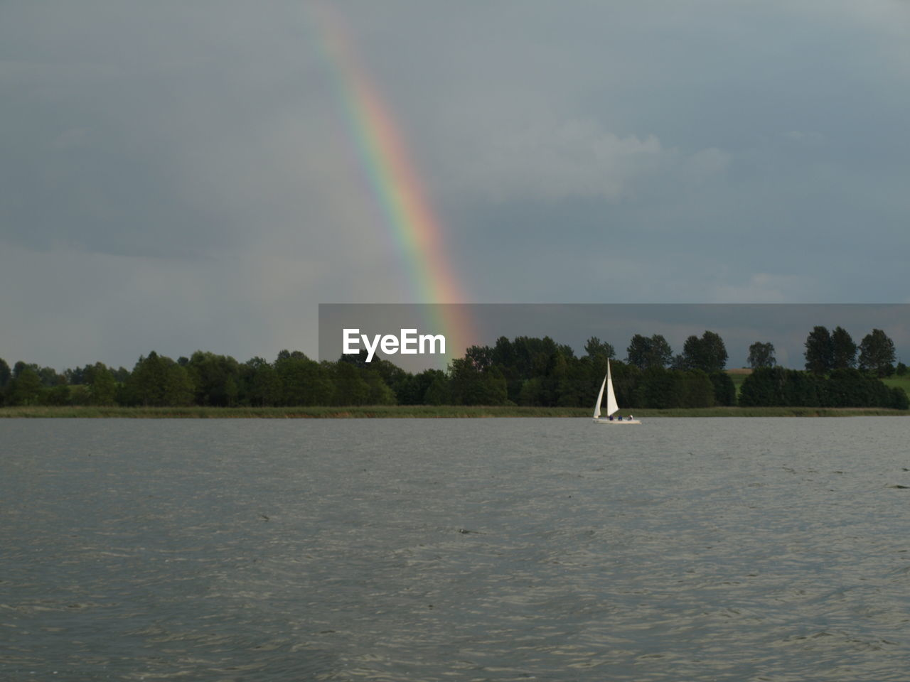 rainbow, nature, water, scenics, outdoors, multi colored, beauty in nature, day, tree, lake, sky, no people
