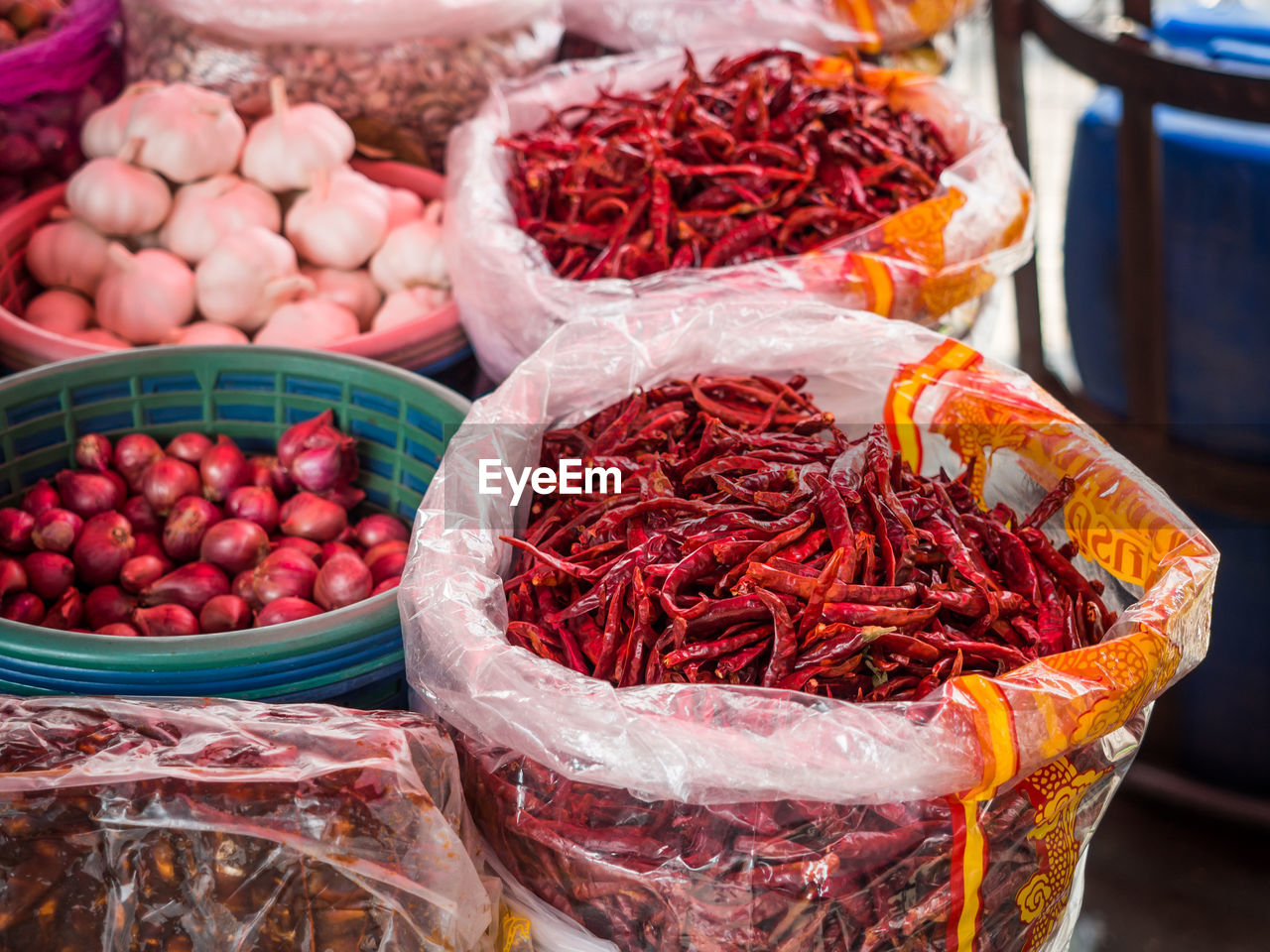 Close-Up Of Red Chili Pepper For Sale At Market Stall