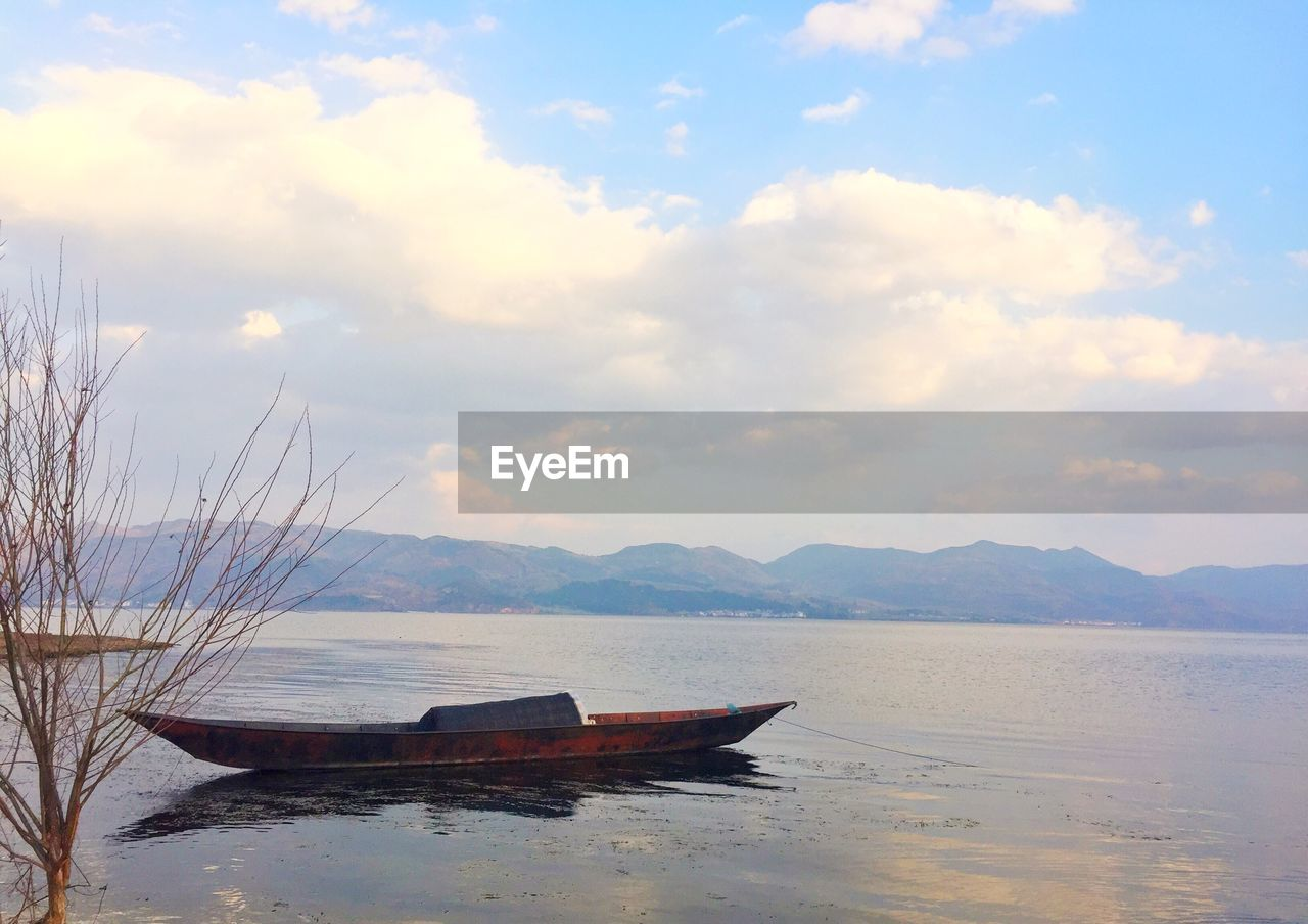 nautical vessel, sky, water, cloud - sky, transportation, mode of transportation, tranquility, scenics - nature, tranquil scene, beauty in nature, mountain, sea, no people, nature, beach, moored, land, day, outdoors, rowboat, anchored
