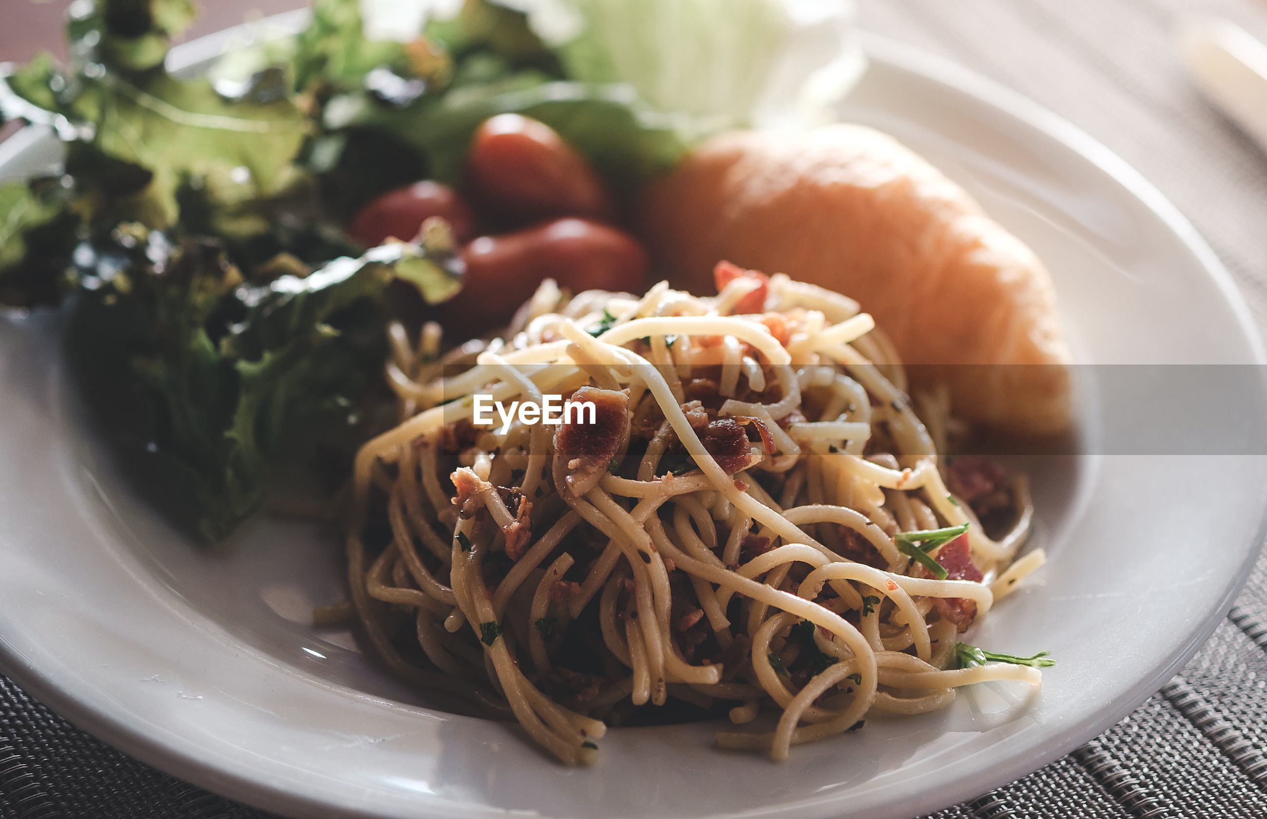 Spicy stir fry noodles, tomato,vegetables and becon
