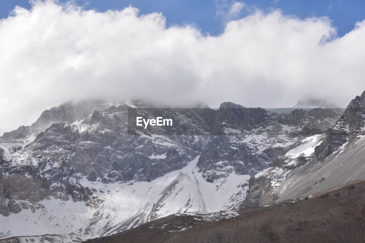 mountain, sky, snow, beauty in nature, scenics - nature, cold temperature, cloud - sky, winter, mountain range, environment, landscape, tranquil scene, tranquility, snowcapped mountain, nature, day, no people, non-urban scene, mountain peak, range