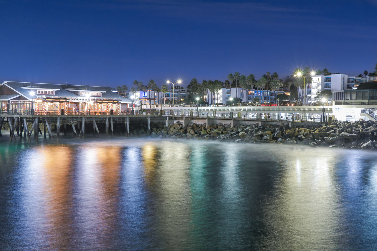 water, architecture, building exterior, built structure, illuminated, waterfront, sky, reflection, night, nature, no people, city, building, river, outdoors, lighting equipment, glowing, blue