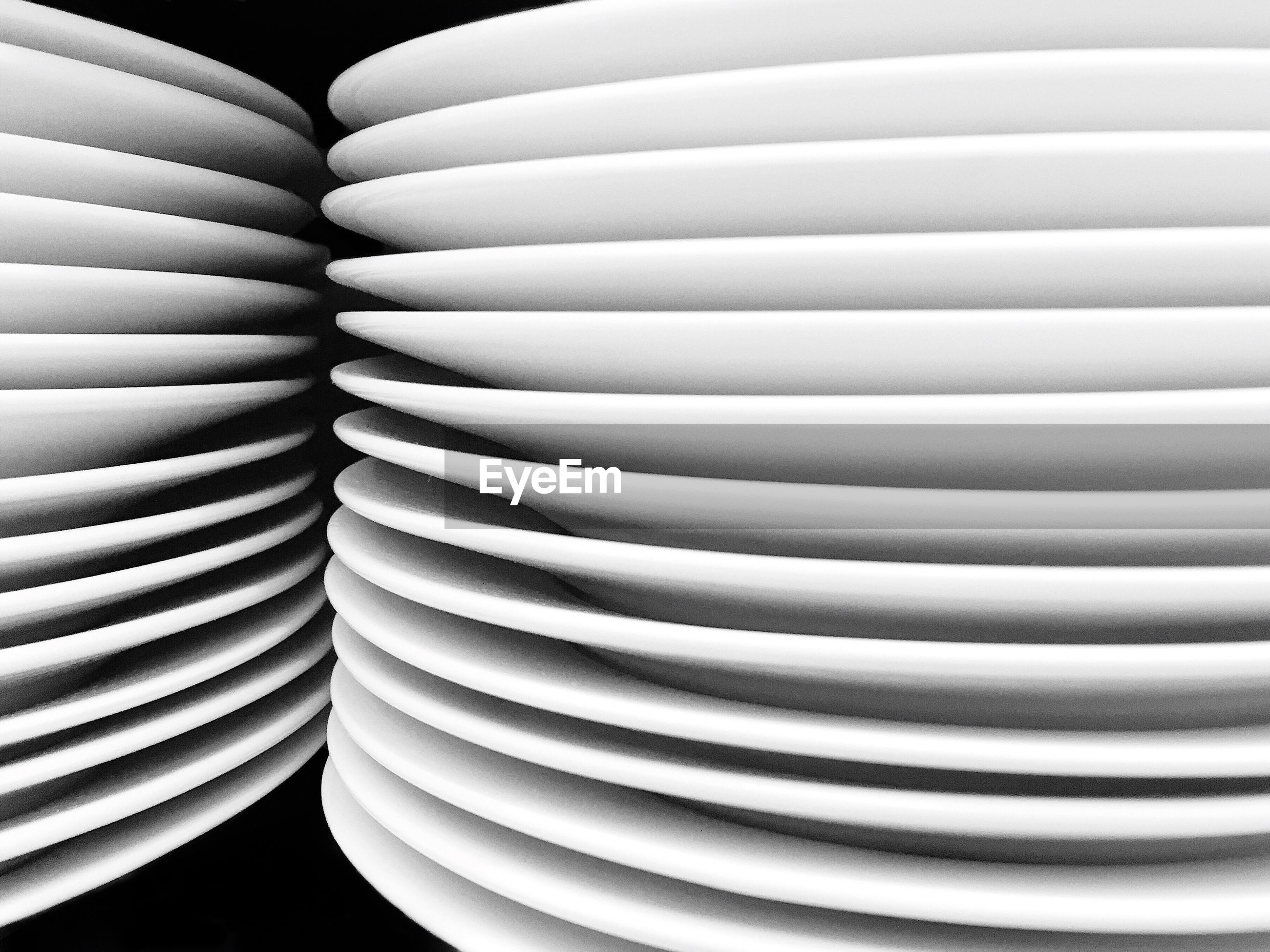 Stack of plates against black background