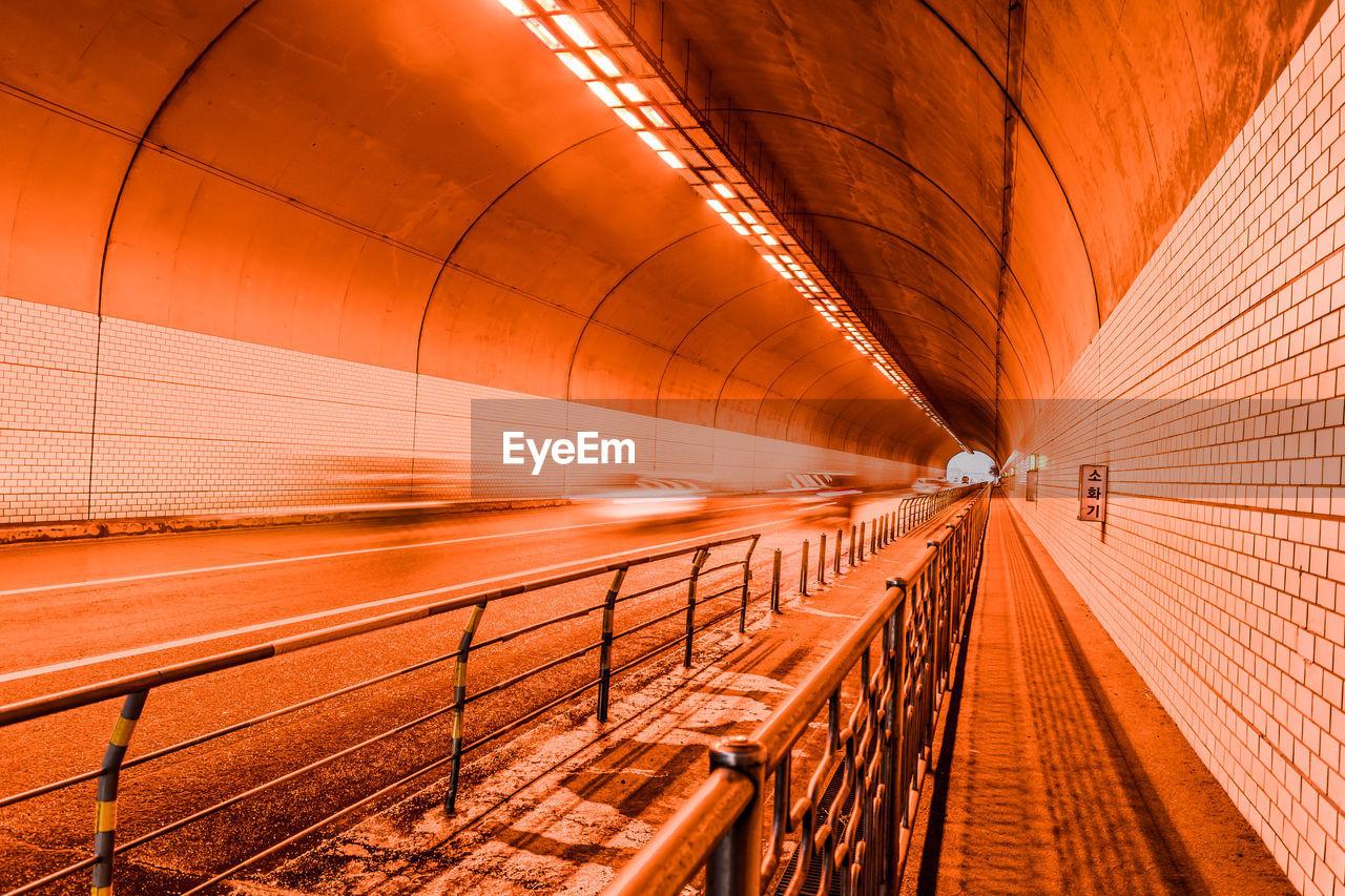 Illuminated Bridge In Tunnel At Night
