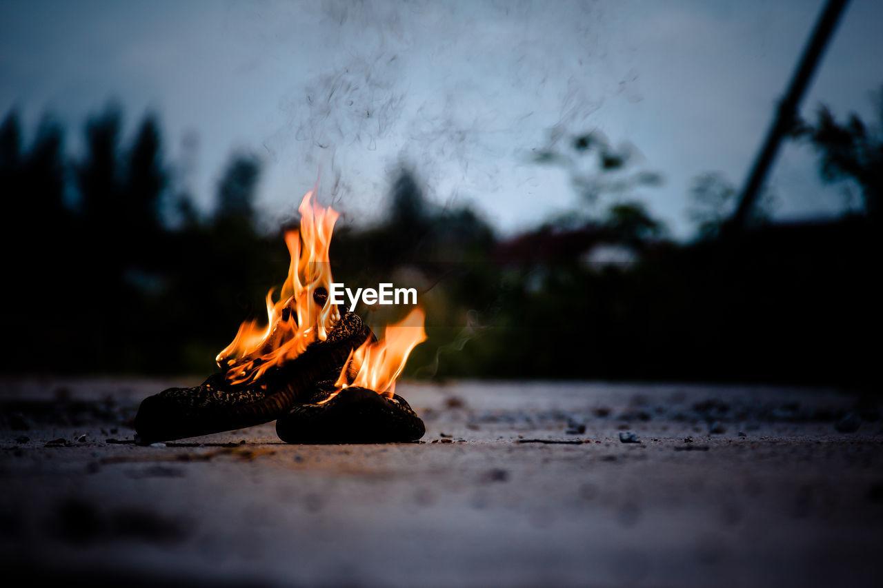 Close-Up Of Burning Wood On Road