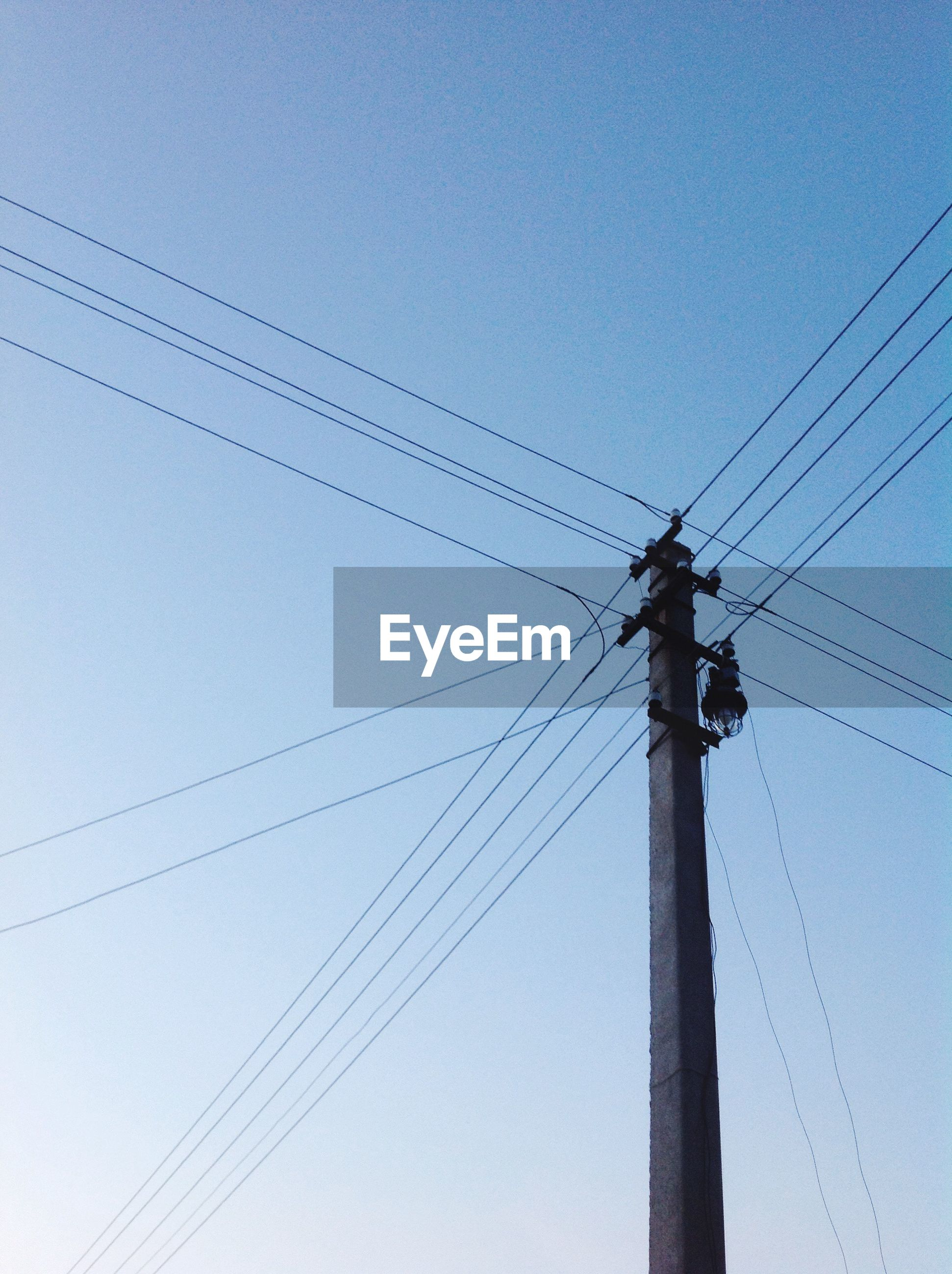 connection, low angle view, cable, blue, electricity, clear sky, fuel and power generation, pole, power line, power supply, day, tall, outdoors, sky, nature, electricity tower, no people, scenics, high section