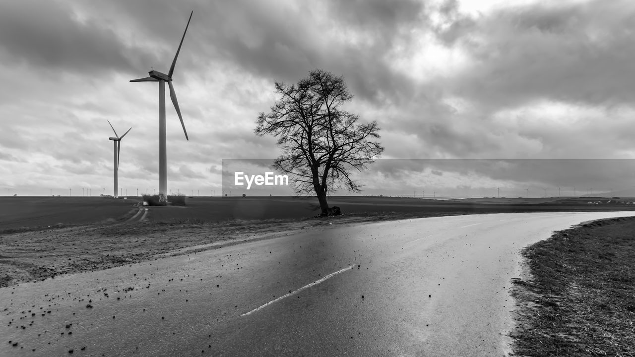 sky, environment, fuel and power generation, road, landscape, cloud - sky, alternative energy, renewable energy, environmental conservation, wind turbine, turbine, nature, land, field, transportation, wind power, no people, day, beauty in nature, scenics - nature