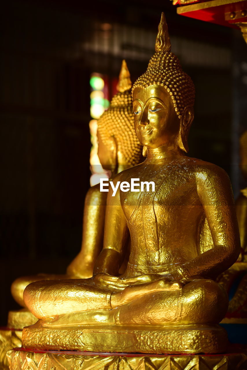 sculpture, religion, art and craft, statue, spirituality, belief, representation, male likeness, gold colored, human representation, creativity, architecture, place of worship, indoors, built structure, building, no people, idol, ornate