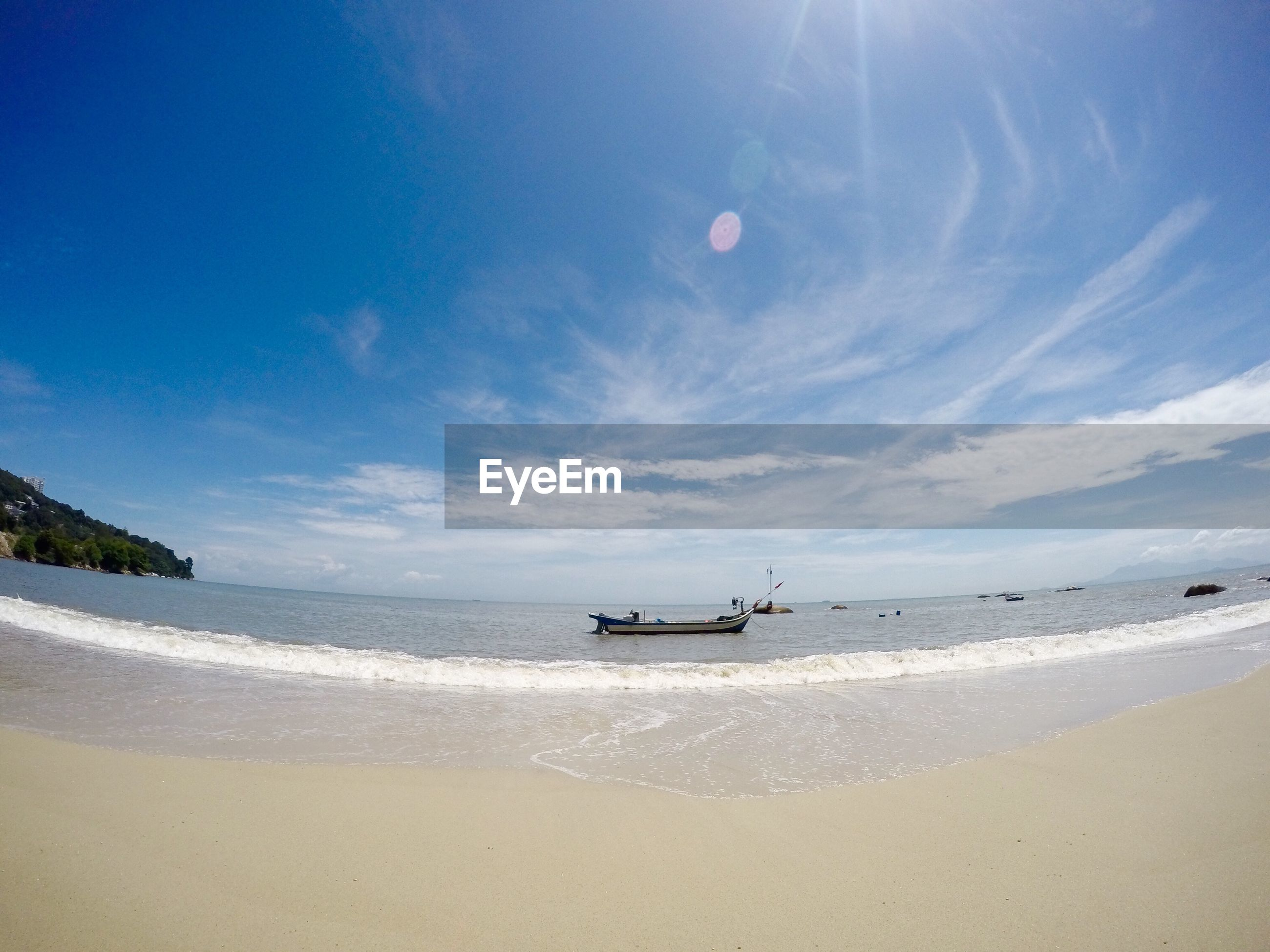 SCENIC VIEW OF PEOPLE ON BEACH AGAINST SKY