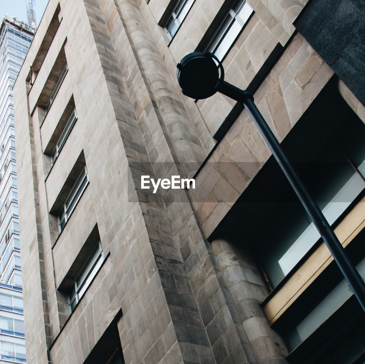 LOW ANGLE VIEW OF ELECTRIC LAMP ON BUILDING