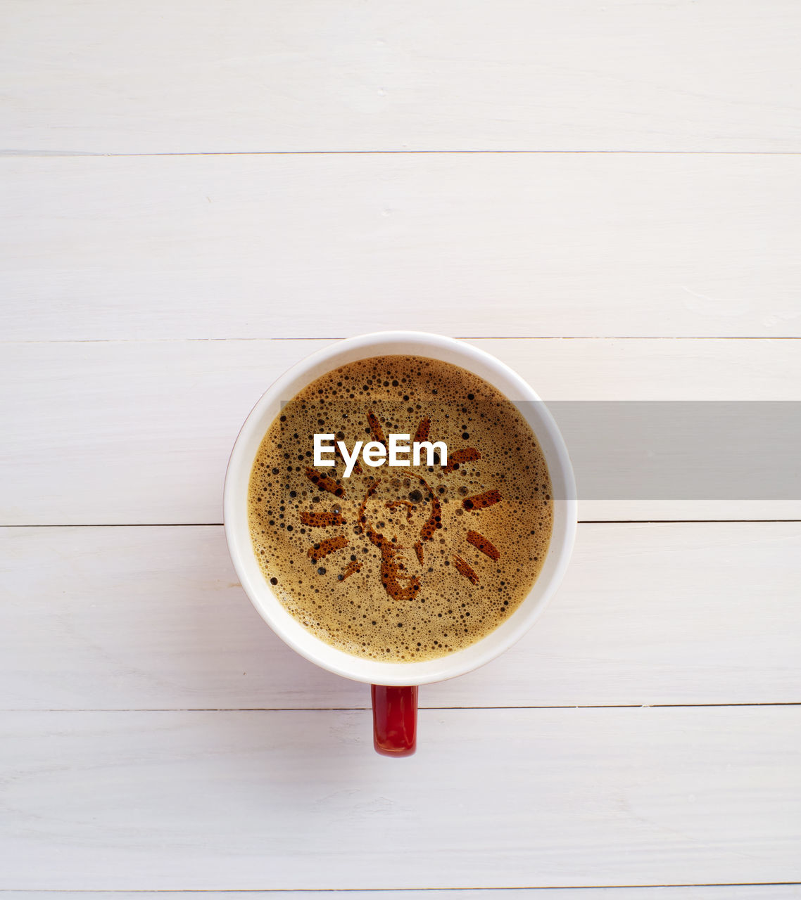 HIGH ANGLE VIEW OF COFFEE CUP WITH TEA