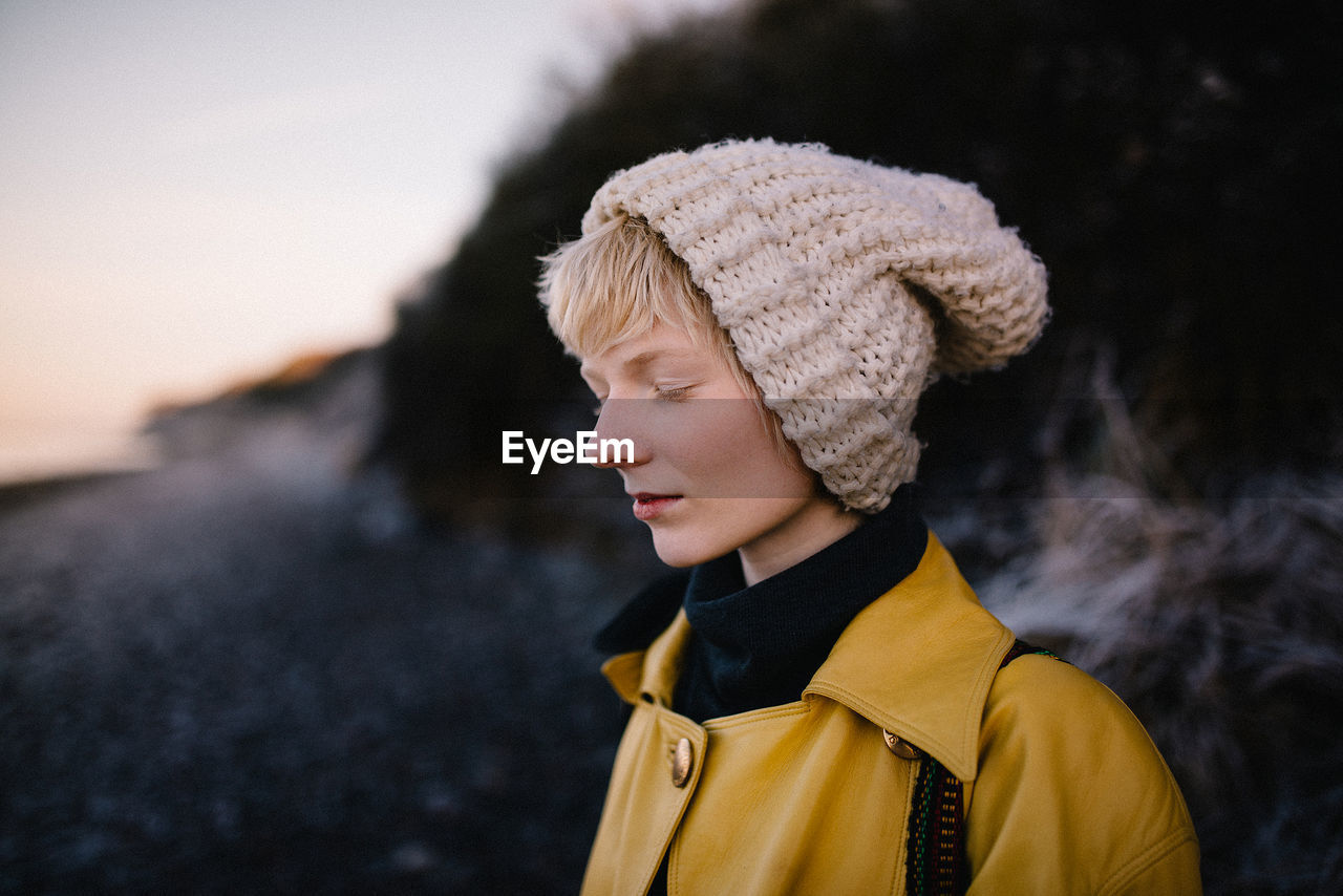 focus on foreground, outdoors, real people, winter, one person, close-up, day, lifestyles, warm clothing, nature, young women, young adult, people