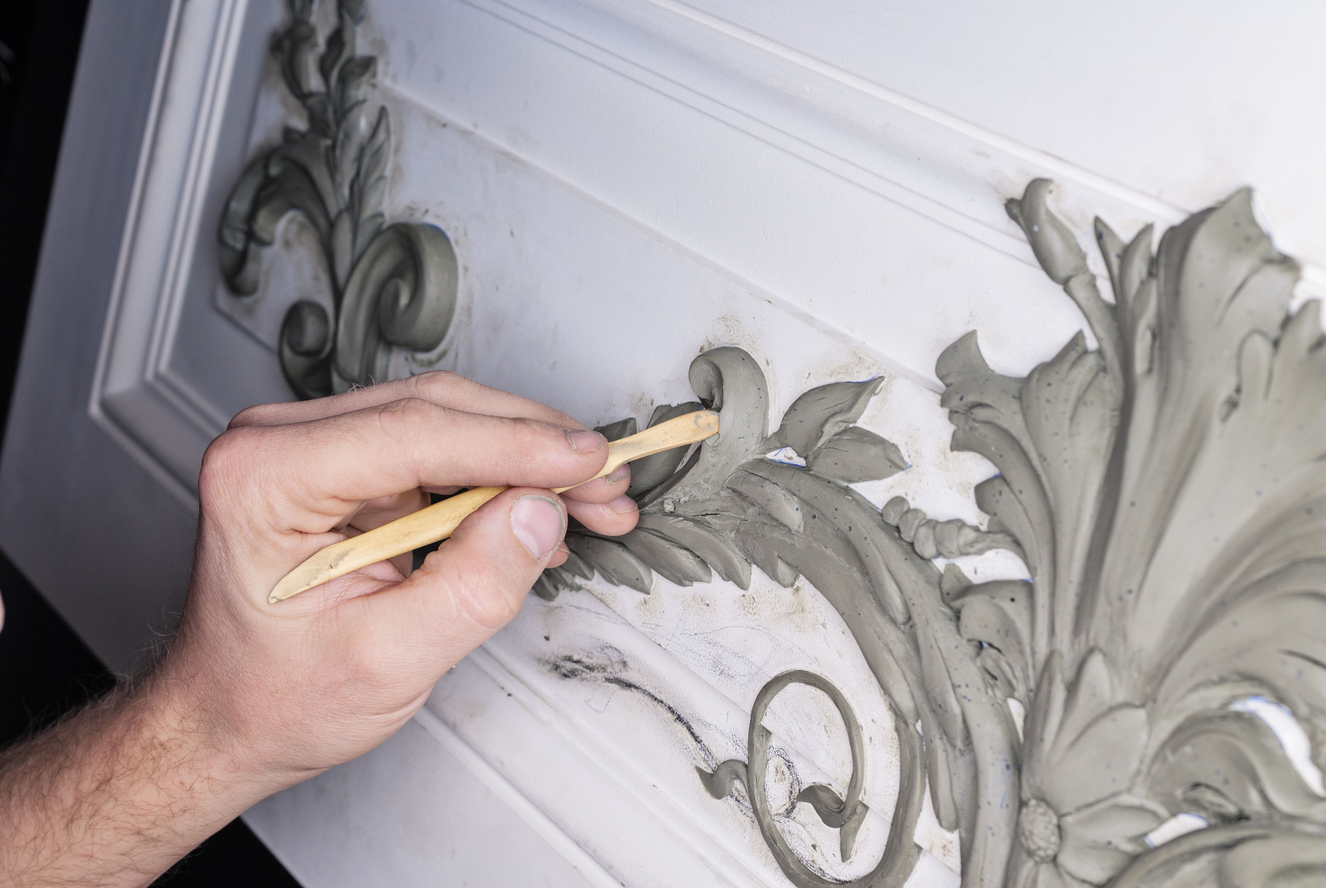 Cropped image of hand carving on wall