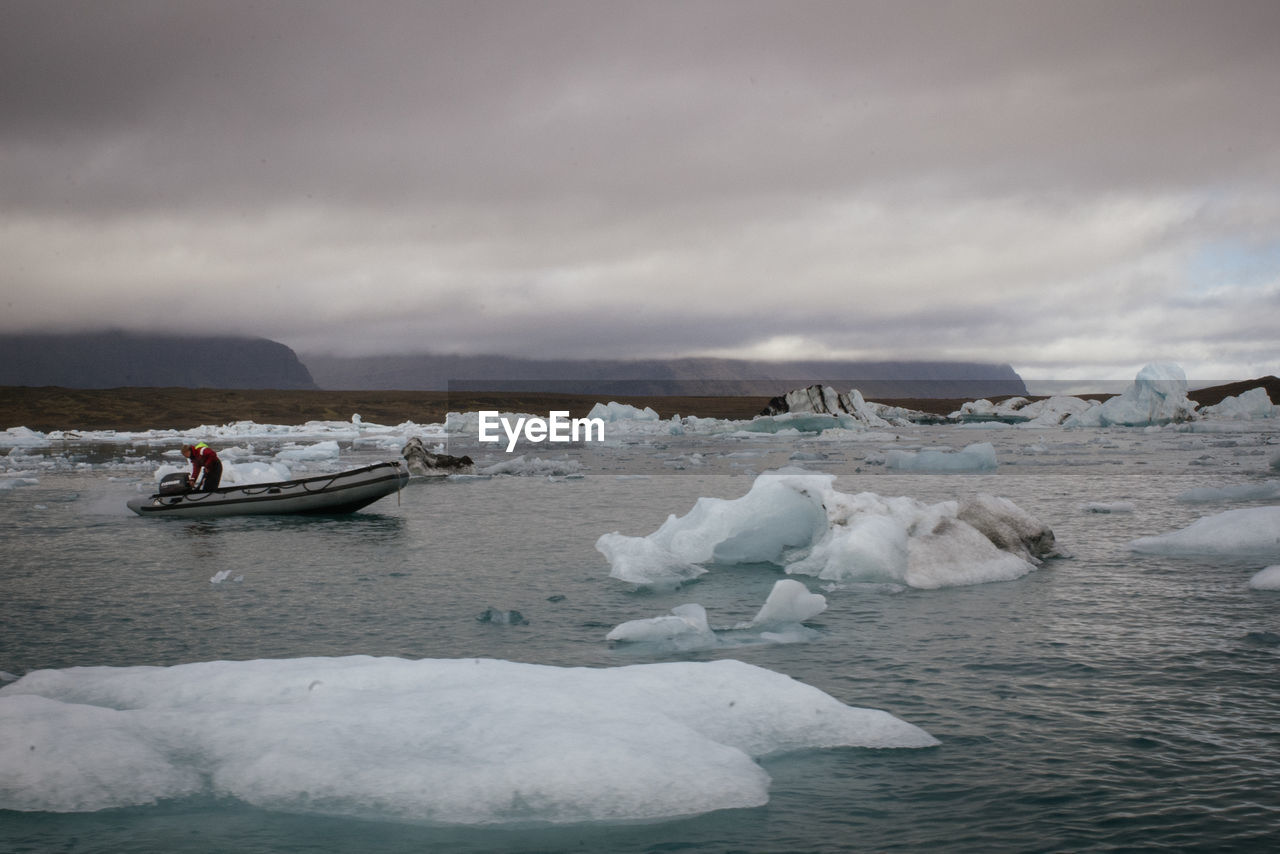 ice, water, iceberg, glacier, cold temperature, nature, sky, tranquility, beauty in nature, sea, winter, waterfront, cloud - sky, floating on water, melting, outdoors, frozen, scenics, day, no people