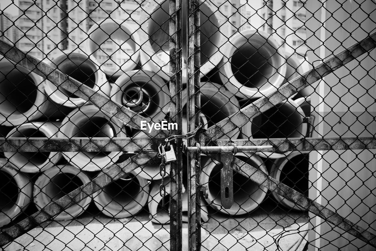 fence, chainlink fence, boundary, barrier, protection, security, metal, day, safety, outdoors, focus on foreground, no people, nature, close-up, land vehicle, monkey, transportation, mode of transportation, primate