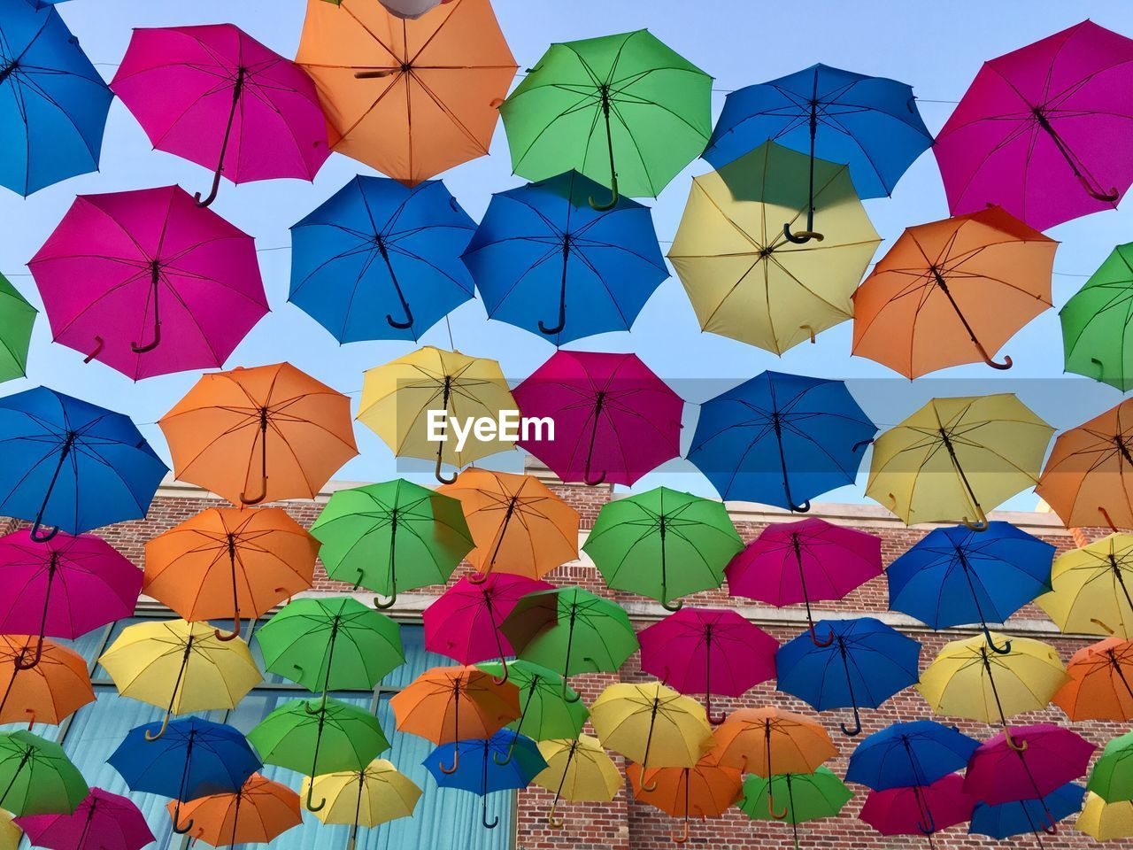 LOW ANGLE VIEW OF COLORFUL UMBRELLAS